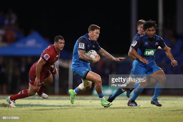 Declan O'Donnell of the Blues offloads the ball during the round 15 Super Rugby match between the Blues and the Reds at Apia Park National Stadium on...