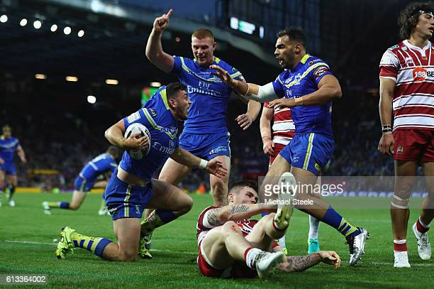 Declan Patton of Warrington celebrates scoring the opening try during the First Utility Super League Final between Warrington Wolves and Wigan...
