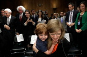 Declan Power Sunstein hugs his mother Samantha Power the nominee to be the US representative to the United Nations at the conclusion of her testimony...