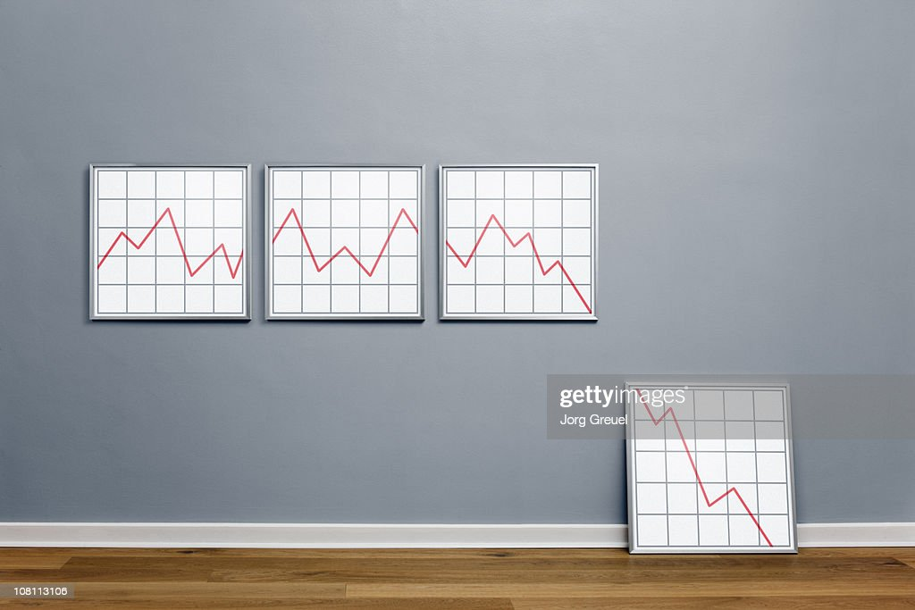 Declining line graph in picture frames