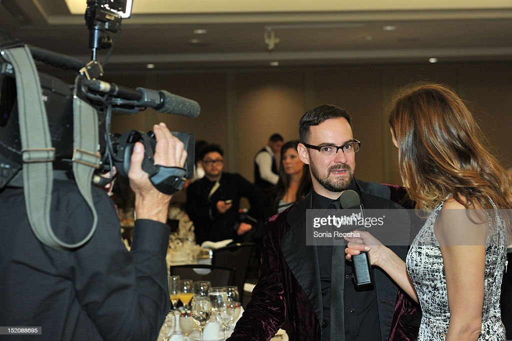 Deco Dawson, winner of the Award for Best Canadian Short Film for 'Keep a Modest Head', is interviewed at the 37th Toronto International Film Festival Award Winner Ceremony held at the InterContinental Toronto Center Hotel on September 16, 2012 in Toronto, Canada.