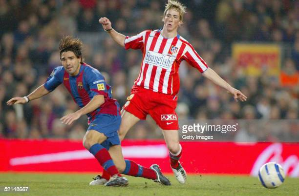 Deco of FC Barcelona is tackled by Fernando Torres of Atletico Madrid during the La Liga match between FC Barcelona and Atletico de Madrid at the...