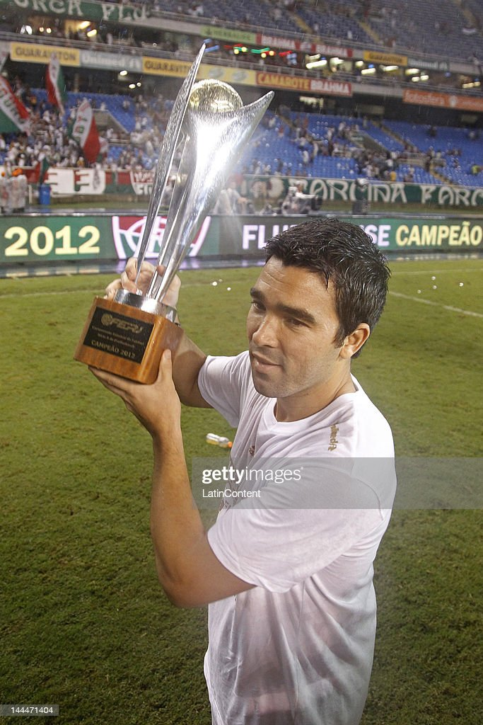 Deco of Fluminense holds the cup and celebrates the State Championship after the final second leg match between Fluminense v Botafogo as part of Rio...