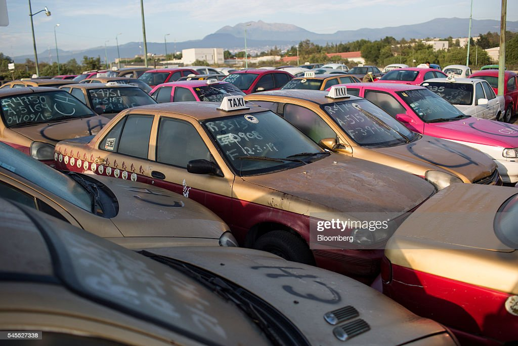 Decommissioned taxis sit in a parking lot in Mexico City, Mexico, on Friday, June 24, 2016. The air quality in Mexico City has risen above the government's acceptable limits triggering restrictions on automobile usage and stricter vehicle emissions testing. Photographer: Brett Gundlock/Bloomberg via Getty Images