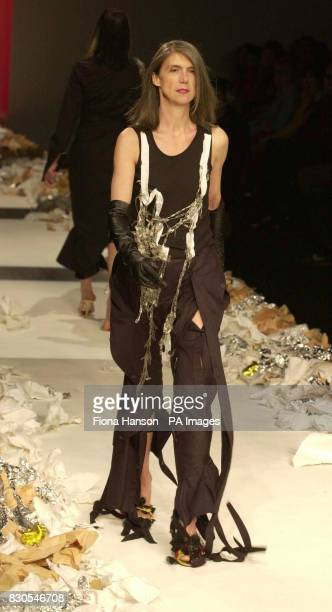 Deconstructed pants with slashed detail worn with a vest and longleather gloves from the Robert CaryWilliams show at the Natural History Museum in...