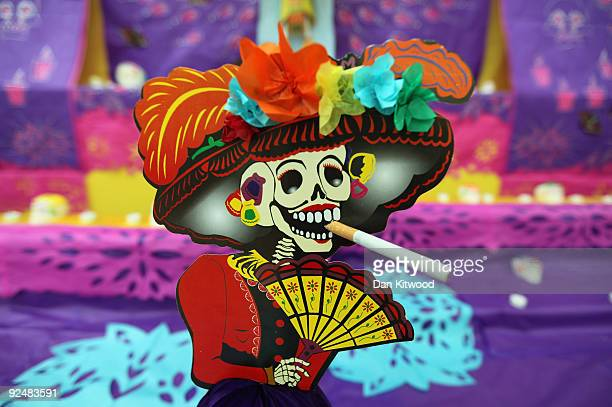 A decorated altar is unveiled for the British Museum�s Day of the Dead celebration on October 29 2009 in London England The altar has been created by...