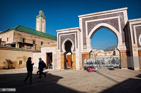Decorated bab/gate and mosque in the medina
