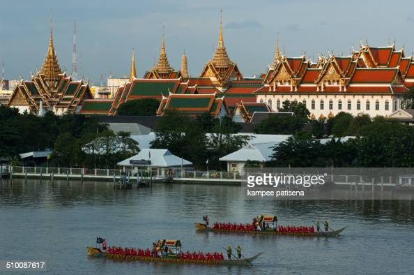 Decorated barge parades at the Chao Phraya River in front of Wat Arun during Fry the Kathina ceremony cloth of Royal Barge Procession in...