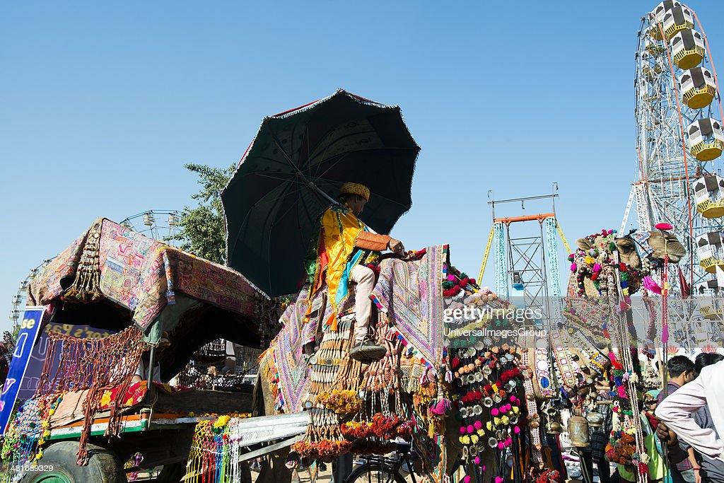 Decorated camel cart in Pushkar Camel Fair Pushkar Ajmer Rajasthan India