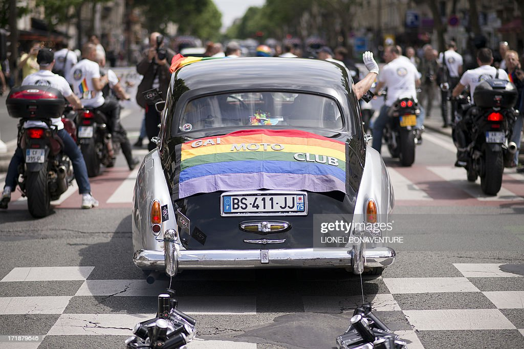 A decorated car and motocyclists parade during the homosexual, lesbian, bisexual and transgender (HLBT) visibility march, the Gay Pride, on June 29, 2013 in Paris. AFP PHOTO / LIONEL BONAVENTURE