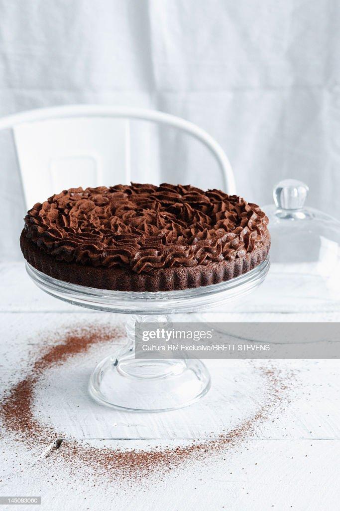 Decorated chocolate cake on platter