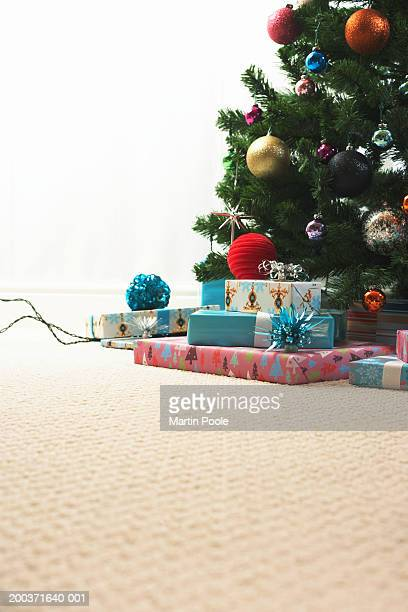 Decorated Christmas tree surrounded by gifts, low section