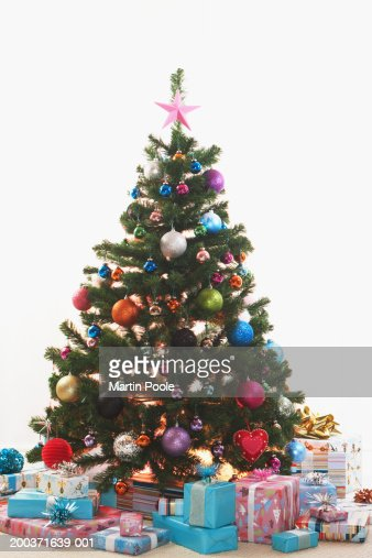 Image result for christmas tree surrounded by gifts