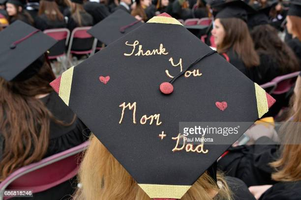 Decorated Commencement Caps at the Boston College 2017 141st Commencement Exercises at Boston College Alumni Stadium on May 22 2017 in Boston...
