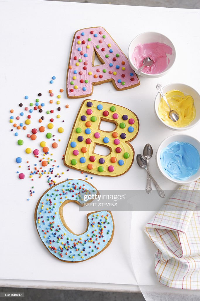 Decorated cookies in letter shapes : Stock Photo
