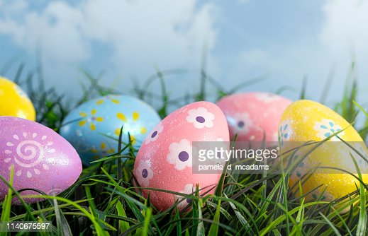 Decorated Easter Eggs Hiding in the Grass on a Beautiful Spring Day : Stock Photo