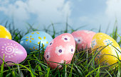 Decorated Easter Eggs Hiding in the Grass on a Beautiful Spring Day