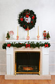 decorated fireplace for christmas with a wreath