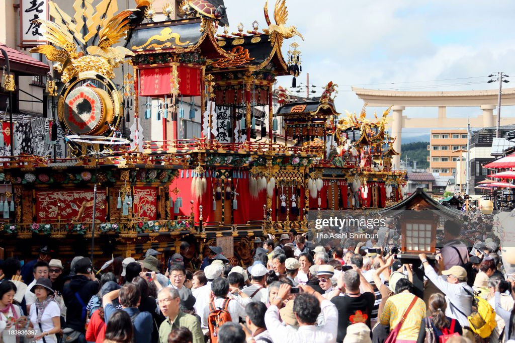 Decorated floats march on during the Autumn Takayama Festival at the front path of the Sakurayama Hachimangu Shrine on October 10, 2013 in Takayama, Gifu, Japan.