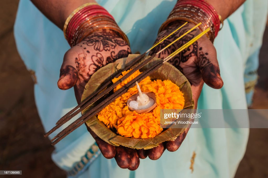 Decorated hands holding traditional offering, Allahabad, Uttar Pradesh, India : Stock Photo