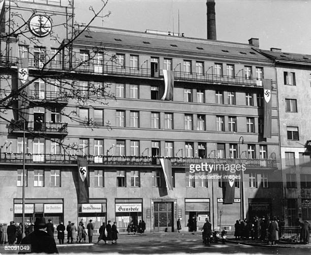 Decorated house of the 'German Party' One year autono mous Slovakia Photograph 1940 [Das Haus der 'deutschen Partei' im Festschmuck 1 Jahr...