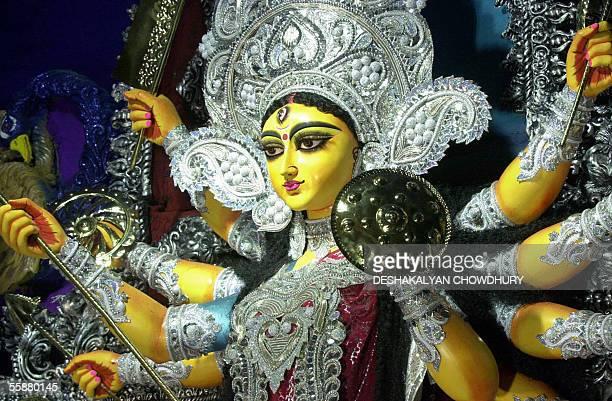 A decorated idol of the tenarmed Hindu Goddess Durga is displayed for worship at a makeshift temple in Kolkata 08 October 2005 The fourday long Durga...