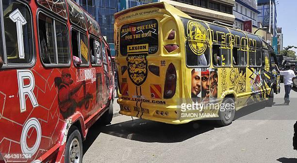 Decorated minisbuses locally known as Matatu are seen along the street in the Kenyan capital Nairobi on February 25 2015 In 2004 Matatu graffiti art...