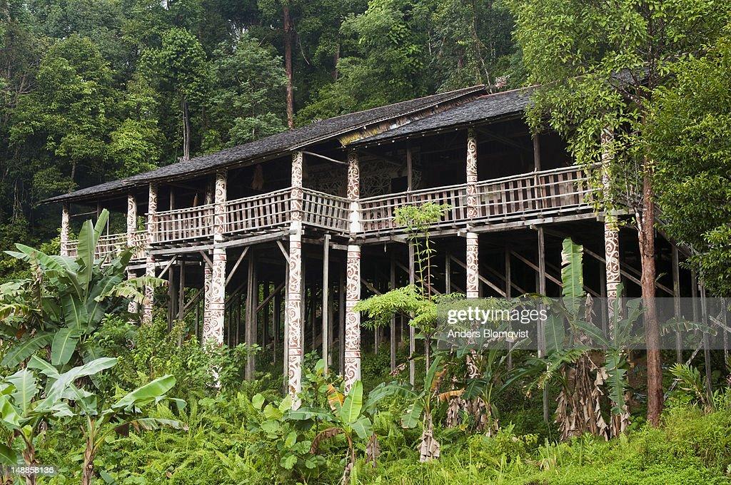 Decorated Orang Ulu tribal longhouse in jungle setting at Sarawak Cultural Village near Kuching.
