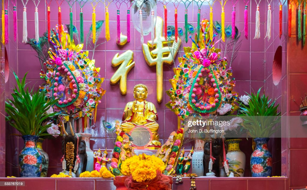 Decorated personal shrine in window sill, Bangkok, Thailand