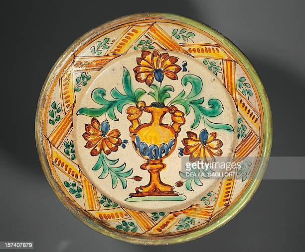 Decorated serving platter with a stylized vase painted maiolica Ariano Irpino manufacture Campania Italy 19th century Ariano Irpino Museo Civico...