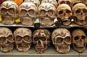 Decorated skulls, ceramics death symbol at market, day of dead, Mexico