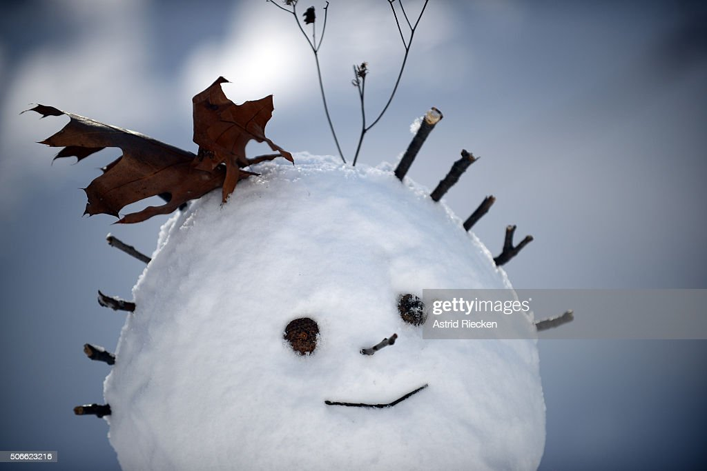 A decorated snowman stnds in Central Park on January 24 2016 in New York City Most of New York's streets were cleaned up over night after a huge snow...