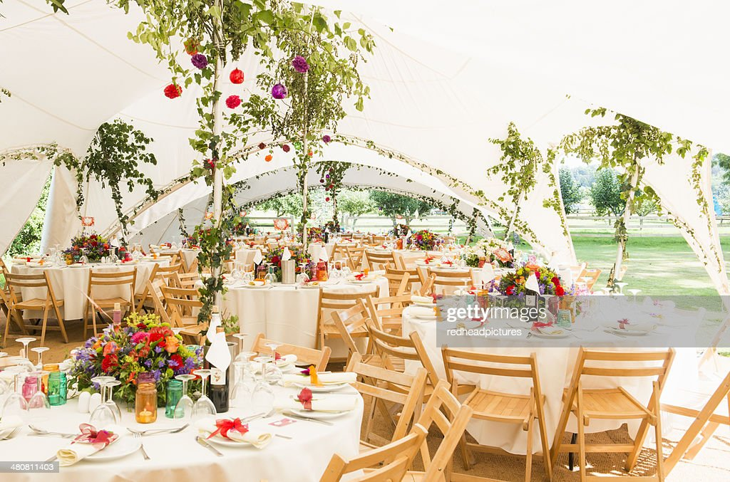 Decorated Tables decorated tables in garden marquee at wedding reception stock