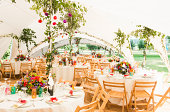 Decorated tables in garden marquee at wedding reception