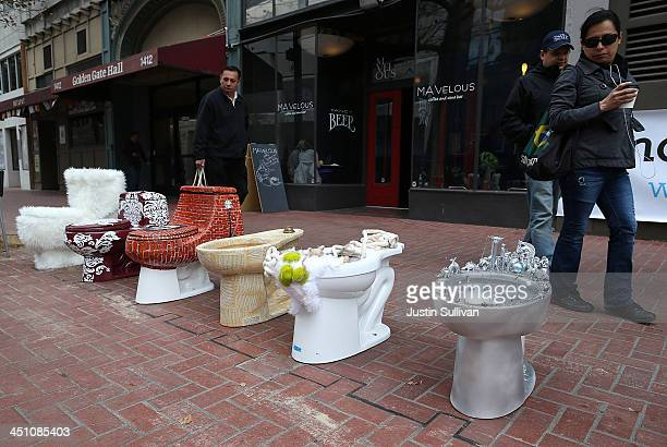 Decorated toilets are displayed as part of a public art installation titled 'C'mon give a shit' to mark World Toilet Day and to bring attention to a...