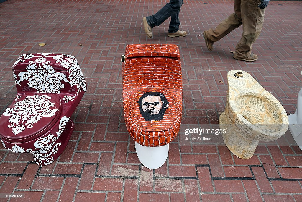 Decorated toilets are displayed as part of a public art installation titled 'C'mon, give a shit' to mark World Toilet Day and to bring attention to a project to convert retired MUNI buses into mobile showers for the homeless on November 21, 2013 in San Francisco, California. Lava Mae founder Doniece Sandoval coordinated the public art installation of decorated toilets to raise awareness about the millions of people around the world who do not have access to clean and private toilets. The installation also promotes the nonprofit Lava Mae's project to convert old San Francisco municipal buses into mobile showers for homeless people in the city.