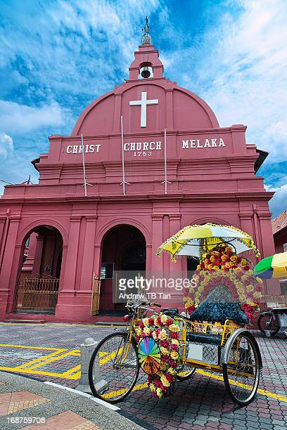 Decorated trishaw in front of Christ Church Melaka