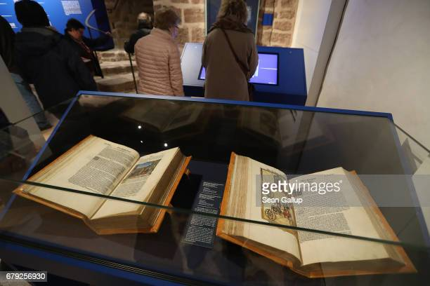 Decorated versions of Martin Luther's translation into German of the Bible known as the Cranach Bibles commissioned by Georg III of Anhalt lie on...