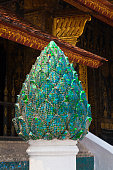 GLASS LOTUS decorates the outside of the Buddhist WAT XIENG THONG (Temple of the Golden City) , built in 1560