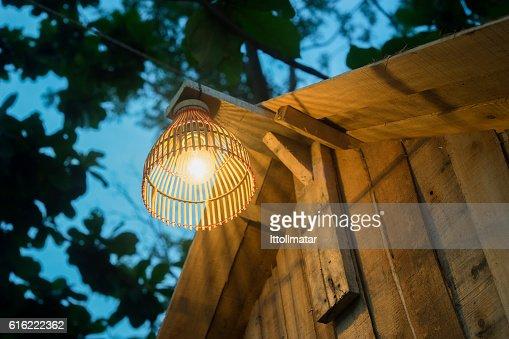 Decorating lantern hanging on wooden bar : Bildbanksbilder