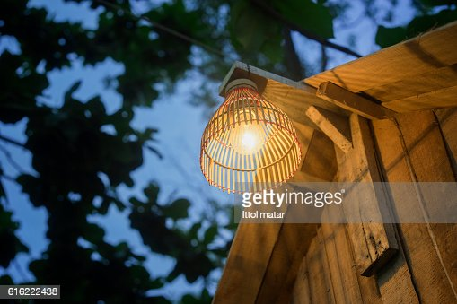 Decorating lantern hanging on wooden bar, : Stockfoto