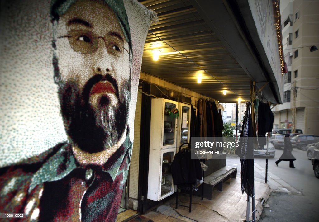 A decoration rug with the picture of Hezbollah's assassinated top commander Imad Mughnieh hangs at a gift shop in Beirut's southern suburbs a...