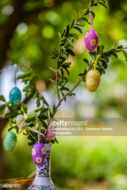 Decoration with colored eggs on a branch in vase