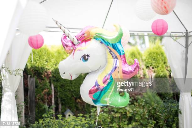 Decoration with unicorn balloon and lampions in a garden