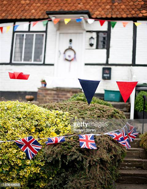 Decorations adorn the houses as part of the Ightham medieval Coxcombe Fair to celebrate Queen Elizabeth II's Diamond Jubilee on June 03 2012 in...