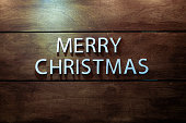Decorations and symbols of christmas newyear on wood background