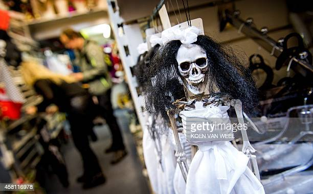 Decorations for Halloween are displayed in a shop in Amsterdam on October 30 2014 More and more Dutch people are taking part in Halloween...