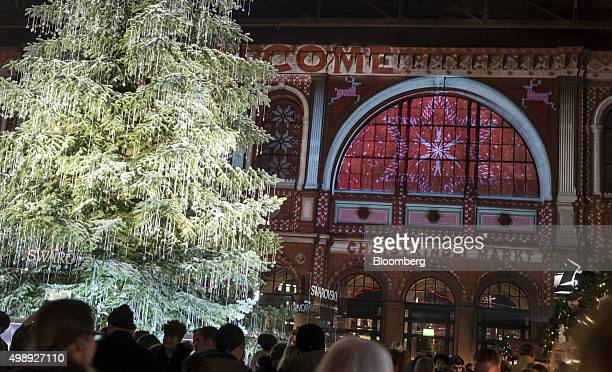 Decorations hang from an illuminated Christmas tree as festive lights illuminate a Christmas market at the main railway station in Zurich Switzerland...