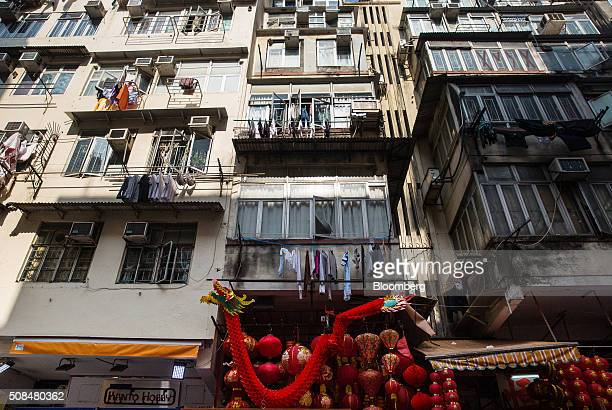 Decorations on sale for Lunar New Year are displayed at market stalls near residential buildings in the Sham Shui Po district of Hong Kong China on...