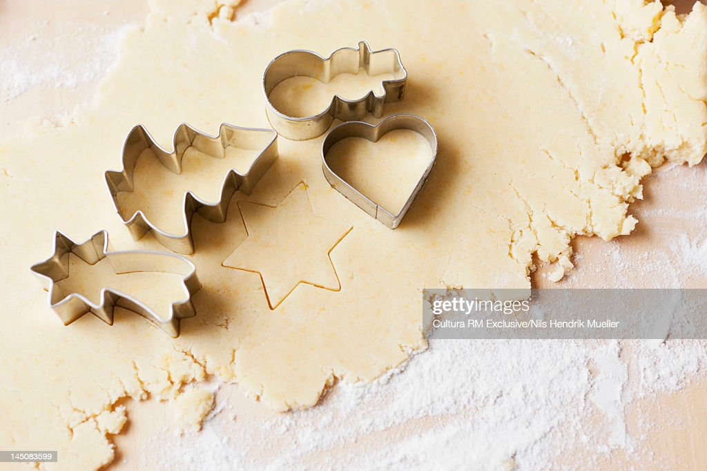 Decorative cookie cutters on dough